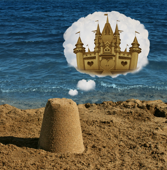Think big concept and positive visualization symbol as an ordinary basic sand shape dreaming and imagining greatness as a majestic castle as a metaphor to imagine future potential and success focus in business and life.